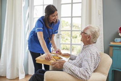 caregiver serves food