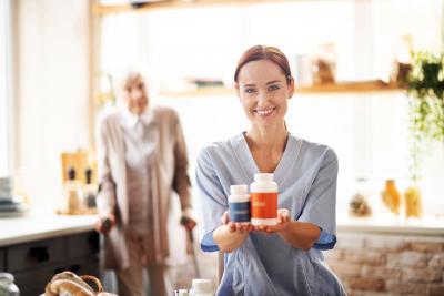 female caregiver showing medicines