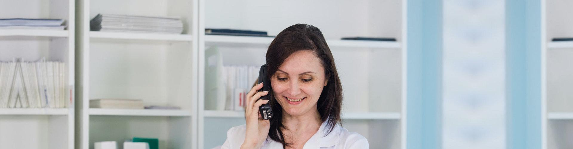smiling woman taking phone call